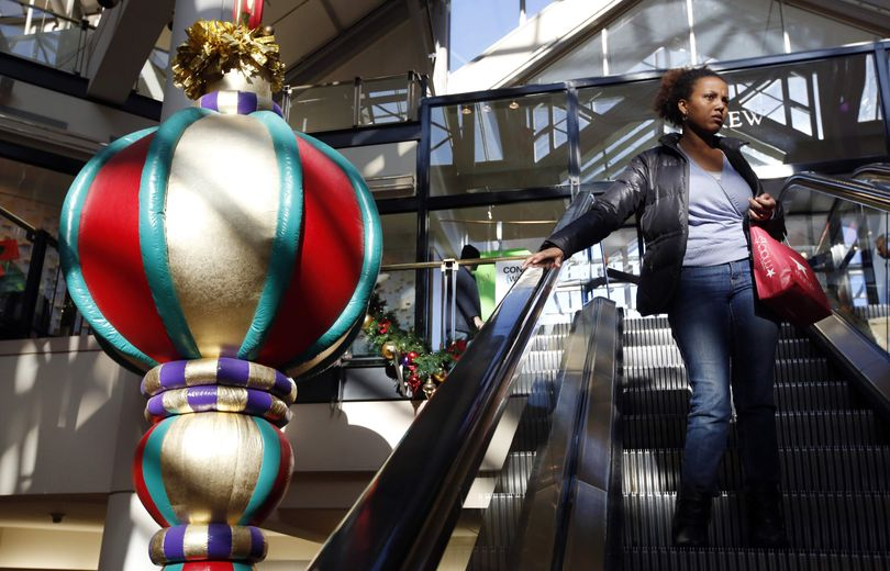 A woman rides the escalator past a giant holiday ornament at the CambridgeSide Galleria mall in Cambridge, Mass., Monday, Dec. 24, 2012. Although fresh data on the holiday shopping season is expected in coming days, early figures point to a ho-hum season for retailers despite last-ditch efforts to lure shoppers over the final weekend before Christmas. And with concerns about the economy and the looming �fiscal cliff� weighing on the minds of already cautious shoppers, analyst say stores will need to offer �once in a lifetime� blowouts to clear out inventory. (Michael Dwyer / Associated Press)