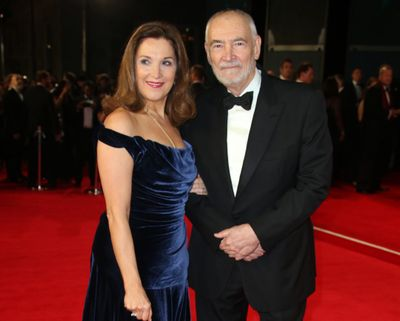 """Barbara Broccoli and Michael G. Wilson attend the 2015 premiere of """"Spectre"""" at Royal Albert Hall in London. (Joel Ryan / Associated Press)"""