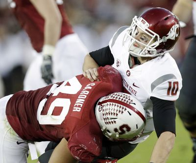 Former WSU QB Jeff Tuel felt the wrath of Ben Gardner and Stanford last season when he was sacked 10 times. (Associated Press)