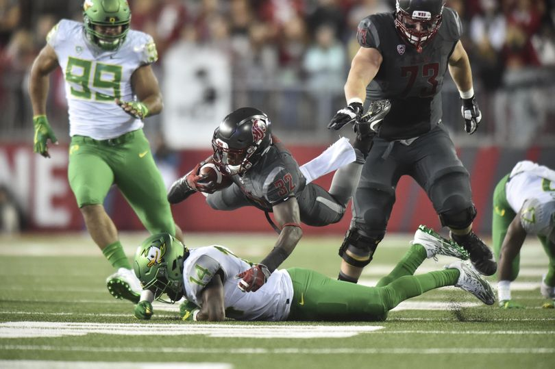 Washington State Cougars running back James Williams (32) flies over the Oregon defense during the second half of a college football game on Saturday, Oct 1, 2016, at Martin Stadium in Pullman, Wash. WSU won the game 51-33. (Tyler Tjomsland / The Spokesman-Review)