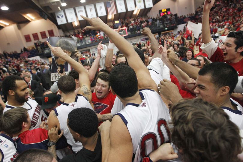 St. Mary's students rush the court to celebrate with players after beating Gonzaga 83-62 in an NCAA college basketball game on Thursday, Jan. 12, 2012, in Moraga, Calif. (Tony Avelar / Fr155217 Ap)