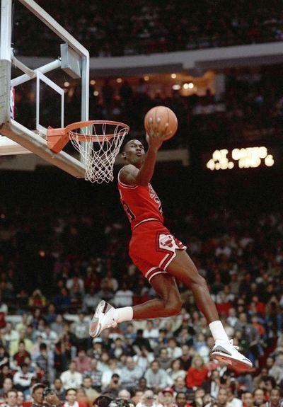 Michael Jordan dunks during the slam-dunk competition of the NBA All-Star weekend on Feb. 6, 1988, in Chicago. Jordan left the old Chicago Stadium that night with the trophy. To this day, many believe Dominique Wilkins was the rightful winner. (JOHN SWART / AP)