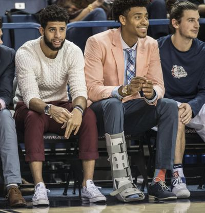 Josh Perkins and Jeremey Jones watch teammates on the floor against West Georgia, Saturday, Nov. 5, 2016, in the McCarthey Athletic Center. (Dan Pelle / The Spokesman-Review)