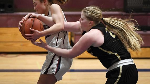 Mt. Spokane guard Destiny Kamalu-Vargas (on left) and Hermiston forward Bailey Young compete for control of the ball during a high school District 8 3A semi-final basketball game, Fri., Feb. 14, 2020, at Mt. Spokane High School. (Colin Mulvany / The Spokesman-Review)