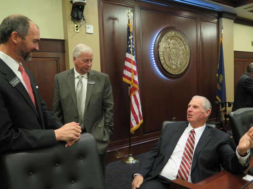 Rep. Tom Loertscher, R-Iona, right, discusses financial disclosure requirements with fellow legislative panel members Reps. Sage Dixon, R-Ponderay, left, and John VanderWoude, R-Nampa, center, after the panel unanimously backed Loertscher's disclosure bill, calling for the full Legislature to pass the bill when it convenes in January. (Betsy Z. Russell)