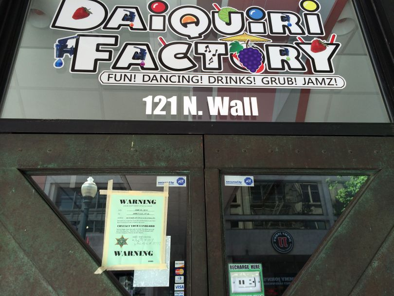 An eviction notice was posted on the doors to the Daiquiri Factory at 121 N. Wall Street on June 23, 2014, in downtown Spokane. (File)