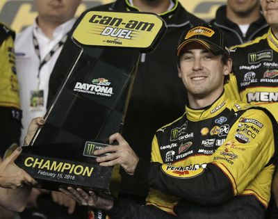 Ryan Blaney raises the trophy in Victory Lane after winning the first of two qualifying races for NASCAR's Daytona 500 at on Thursday night at Daytona International Speedway. (Chuck Burton / Associated Press)