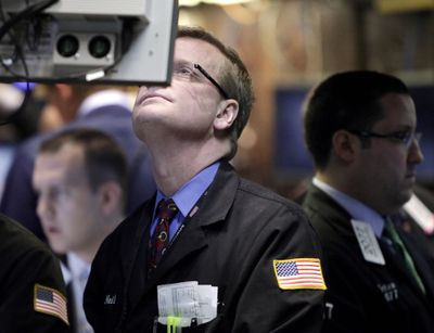 Traders work on the floor at the New York Stock Exchange on Thursday. Recent market gains have investors optimistic. (Associated Press / The Spokesman-Review)
