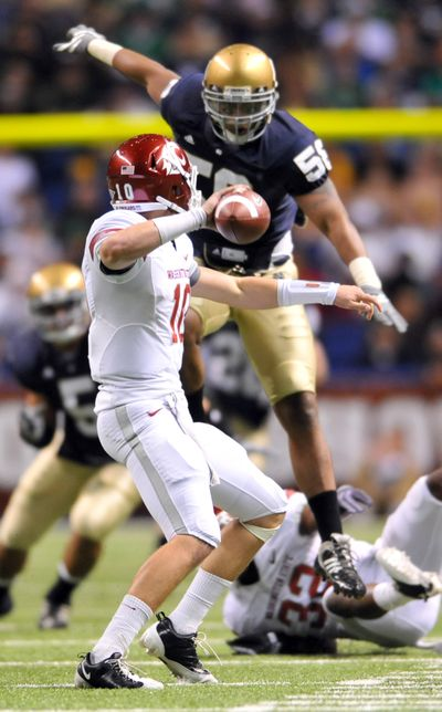 WSU's Jeff Tuel is pressured into an incomplete pass by Notre Dame's Brian Smith.  (Associated Press / The Spokesman-Review)
