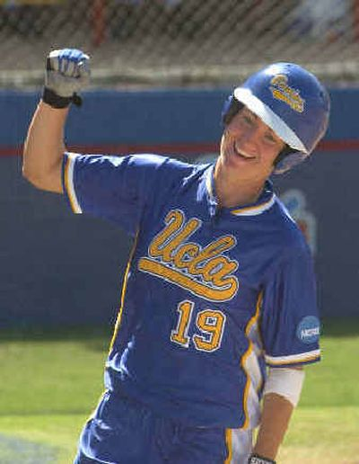 UCLA's Caitlin Benyi celebrates scoring the go-ahead run against Stanford in the 12th inning Sunday. UCLA's Caitlin Benyi celebrates scoring the go-ahead run against Stanford in the 12th inning Sunday.   (Associated PressAssociated Press / The Spokesman-Review)