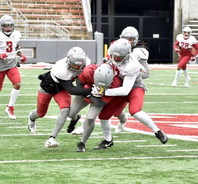 Washington State's Armani Marsh (left) and Justus Rogers (right) converge on the ballcarrier during the Cougars' scrimmage Saturday afternoon at Martin Stadium.  (Washington State Athletics)