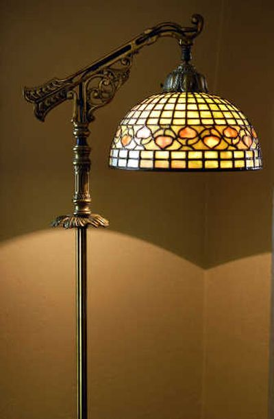 At right is a Briggs' creation that he dubbed Merlot. In the photo below, Briggs' beautiful Tiffany-style lamp is known as Acorn. He creates one lamp per year.  (Photos by Jed Conklin/ / The Spokesman-Review)