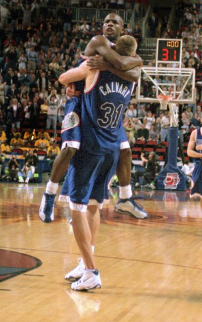 In this 1999 file photo, Gonzaga guard Quentin Hall hugs teammate Casey Calvary (31) after Calvary tipped in the winning basket to beat Florida in the Sweet 16. (Colin Mulvany / The Spokesman-Review)