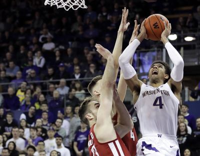 Washington guard Matisse Thybulle (4) shoots against Washington State forwards Jeff Pollard, left, and Aljaz Kunc, second from left, during the first half of an NCAA college basketball game, Saturday, Jan. 5, 2019, in Seattle. (Ted S. Warren / AP)