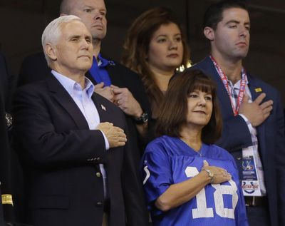 Vice President Mike Pence and his wife, Karen, stand during the playing of the national anthem before an NFL football game between the Indianapolis Colts and the San Francisco 49ers, Sunday, Oct. 8, 2017, in Indianapolis. (Michael Conroy / Associated Press)