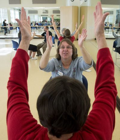 "Shirley Hernandez, who has a nerve disorder called essential tremors, stretches during a special dance class for Parkinson's disease patients run by the dance department at Gonzaga University. ""It helps my movement, my mind and it helps me have fun,"" said Hernandez. (Colin Mulvany)"