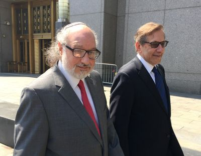 Convicted spy Jonathan Pollard, left, with his lawyer, Eliot Lauer, leaves federal court July 22, 2016, in New York following a hearing, Pollard, the former Navy intelligence analyst who served 30 years in prison for selling secrets to Israel, has completed his parole, the Justice Department said Friday, Nov. 20, 2020. (Associated Press)