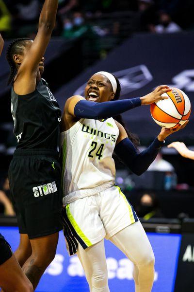 Seattle guard Jewell Loyd, left, fouls Dallas guard Arike Ogunbowale in the fourth quarter of a WNBA game, Sunday, June 6, 2021, in Everett.  (Bettina Hansen/Seattle Times)