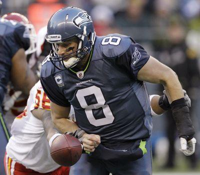 Kansas City's Derrick Johnson knocks the ball loose from Seattle's Matt Hasselbeck. The Chiefs recovered. (Associated Press)