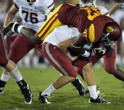 USC punished WSU QB Jeff Tuel last season, but he has fond memories of his first start. (Associated Press)