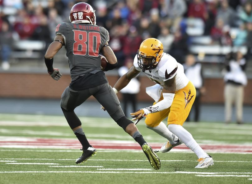 WSU receiver Dom Williams (80) slips an Arizona State tackle and runs for a touchdown during the second half of a Pac-12 college football game on Saturday, Nov 7, 2015, at Martin Stadium in Pullman, Wash. WSU won the game 38-24. (Tyler Tjomsland / The Spokesman-Review)