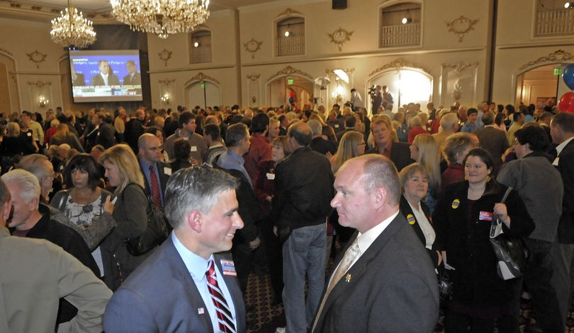 Michael Baumgartner, left, and Spokane County Sheriff Ozzie Knezovich talk during a Republican Party election night celebration at the Davenport Hotel on Tuesday, Nov, 2, 2010. (Christopher Anderson / The Spokesman-Review)