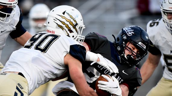 Mead lineman Riley Ayala, left, stops Mt. Spokane fullback Hudson Gilbert before the line of scrimmage during the Wildcats' Greater Spokane League win Friday at Union Stadium in Spokane.  (James Snook/For The Spokesman-Review)