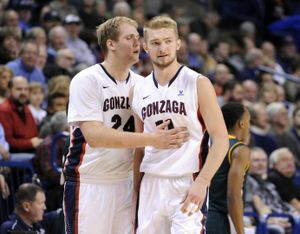 Gonzaga's Domantas Sabonis, right, and teammate Przemek Karnowski will combine with Kyle Wiltjer to occasionally form the 'Spokane Skyline' that will create matchup issues for opponents this season. (Jesse Tinsley / The Spokesman-Review)