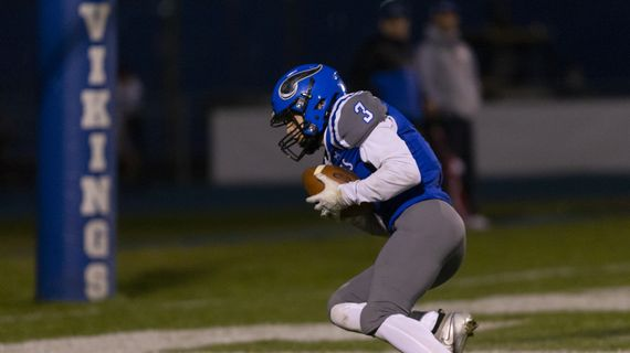 Ethan Garitone scores one of his two touchdowns and Coeur d'Alene defeated visiting Lake City 64-34 on Friday, Oct. 16, 2020.  (Cheryl Nichols/For The Spokesman-Review)