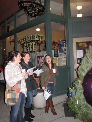 Neighbors sing carols outside the Perry Street Cafe on Dec. 13 2011