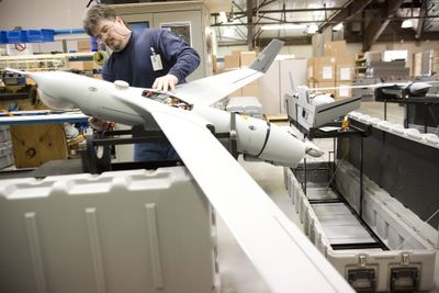 Jim McClanahan assembles an unmanned surveillance aircraft at the Insitu production facility in Bingen, Wash., on April 23. (Associated Press / The Spokesman-Review)