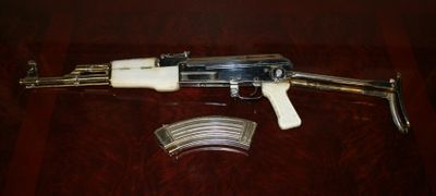 This pearl-handled AK-47, which belonged to Iraqi dictator Saddam Hussein, will be sent back to the Iraqi government.  (Associated Press / The Spokesman-Review)