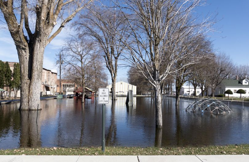 The park in the center  of Sprague, Washington, is under two to three feet of water from the nearby creek, which flooded several parcels of land around it before being contained by sandbags and berms Sunday. (Jesse Tinsley / The Spokesman-Review)