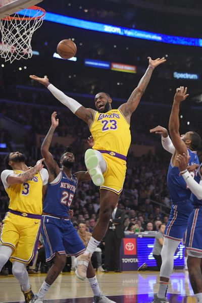 Los Angeles Lakers forward LeBron James (23) has the ball knocked from his hands while trying to shoot by New York Knicks guard Wayne Ellington, right, as forward Anthony Davis, left, and guard Reggie Bullock vie for position during the first half of an NBA basketball game Tuesday, Jan. 7, 2020, in Los Angeles. (Mark J. Terrill / Associated Press)