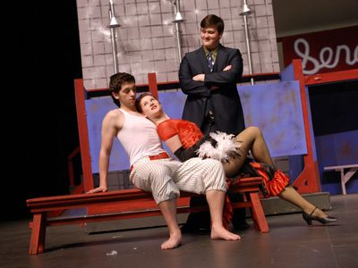 """University High School presents the  musical """"Damn Yankees.""""  Pictured are cast members Patrick Wolfe  as Joe Hardy, Jessii  Arp as Lola and Danny Bush as Mr. Applegate.  (J. BART RAYNIAK / The Spokesman-Review)"""