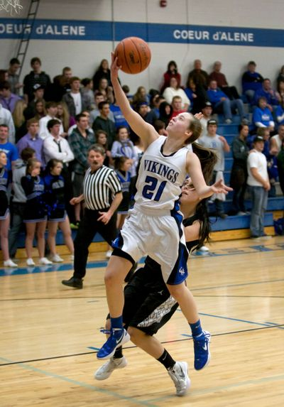 Coeur d'Alene's Erin Legel goes up for a layup on a fast break as Post Falls' Lexi Smith defends in the third quarter. (BRUCE TWITCHELL)