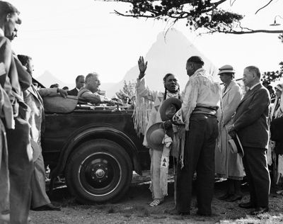 """In this Aug. 5., 1934,  photo, President Franklin D. Roosevelt and  Eleanor Roosevelt are inducted into the Blackfeet tribe near Two-Medicine Chalet, Glacier National Park. After the president had been installed as """"Lone Chief,""""  Eleanor Roosevelt received the title of """"Medicine Pipe Woman.""""  (Associated Press)"""
