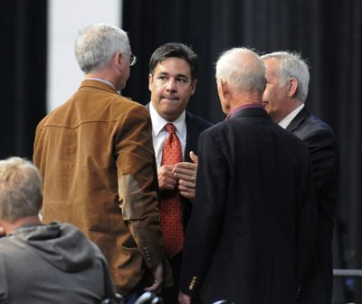 U.S. Rep. Raul Labrador listens to the parliamentarians as they try to resolve a motion on the floor during the last day of the Idaho Republican Convention on Saturday, June 14, 2014, in Moscow, Idaho. (Kyle Miles / Lewiston Tribune via Associated Press)