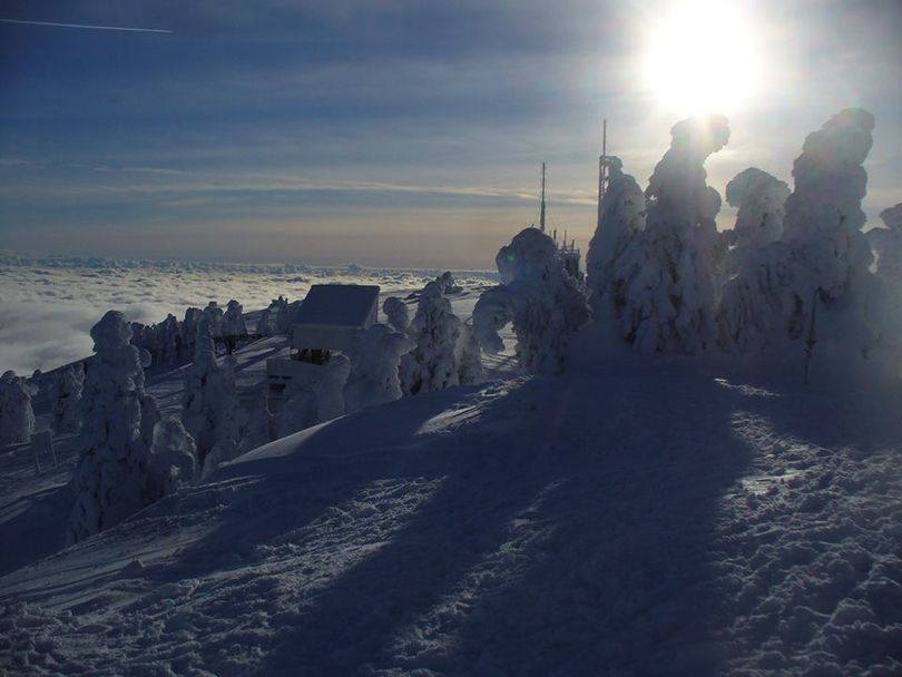 Snow ghosts loom on the summit of Mount Spokane above the valley fog. (Cris Currie)