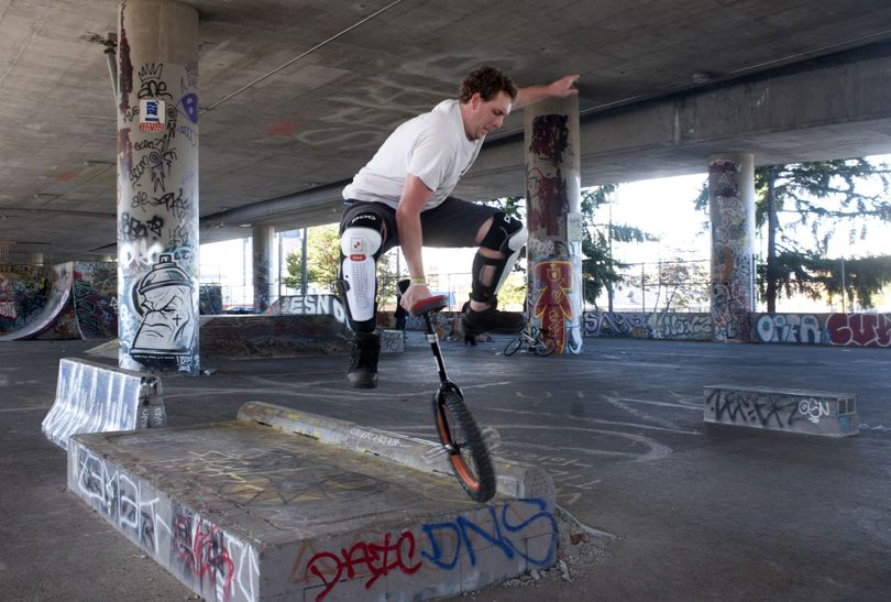 Phil Sanders, 26, performs a trick off an obstacle with his unicycle at the skate park under the freeway near Fourth Avenue and McClellan Street in Spokane on Wednesday. Sanders said he isn't intimidated by the people who hang out there. (Jesse Tinsley)