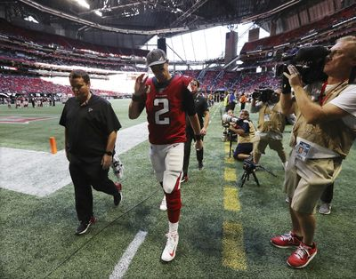 Atlanta Falcons quarterback Matt Ryan (2) leaves the field with an apparent leg injury after Los Angeles Rams defensive tackle Aaron Donald leveled him, causing a fumble that the Rams recovered, during the fourth quarter in an NFL football game Sunday, Oct. 20, 2019, in Atlanta. (Curtis Compton / Atlanta Journal-Constitution via AP)