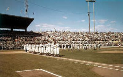 The Spokane Indians baseball team and the team from Salt Lake City line up before the National Anthem on opening day of the 1960 season. The Spokesman-Review archive  (File photos  archive / The Spokesman-Review)