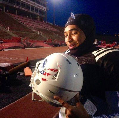 Eastern Washington quarterback Vernon Adams shows off one of the team's new white helmets.