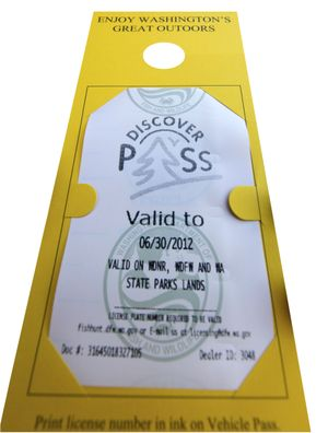 Washington's Discover Pass was introduced in 2011, requiring the $30 annual pass to enter state parks and most other state lands. Sales of the pass did not initially meet expectations, forcing the cash-strapped State Parks to issue pink slips to eliminate 160 of the agency's 516 full-time employees. (Associated Press)