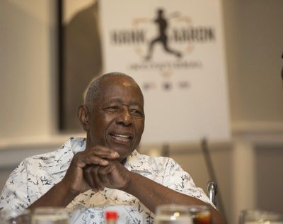 Hank Aaron answers questions from the crowd during the Hank Aaron Invitational at SunTrust Park in Atlanta, Aug. 2, 2019. (Steve Schaefer / Atlanta Journal-Constitution via AP)