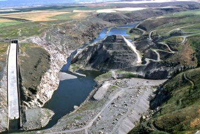 This 2002 image  shows an upstream view of remnants of the Teton Dam. When the brand-new Teton Dam gave way on June 5, 1976, 80 billion gallons of water surged down the valley of eastern Idaho farming towns. The structure at left was the dam's spillway.   (Associated Press / The Spokesman-Review)