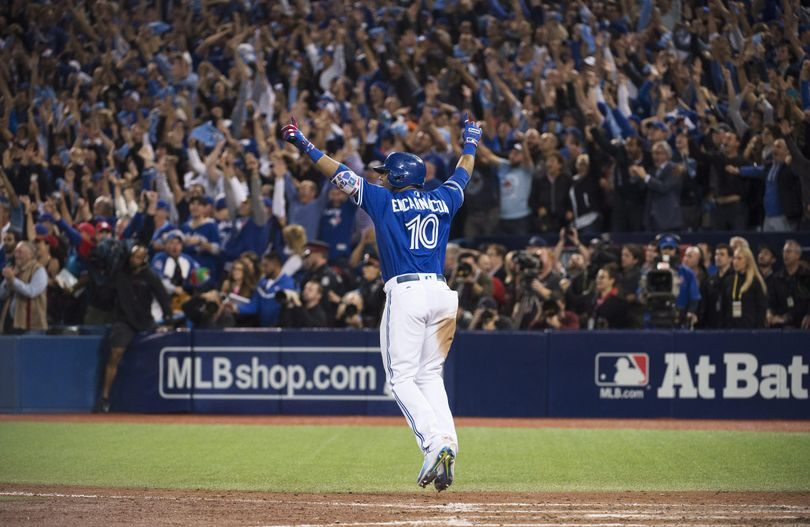 Toronto's Edwin Encarnacion celebrates his winning walk-off three-run home run against the Baltimore Orioles during the 11th inning of the American League wild-card game in Toronto on Tuesday. (Nathan Denette / Associated Press)