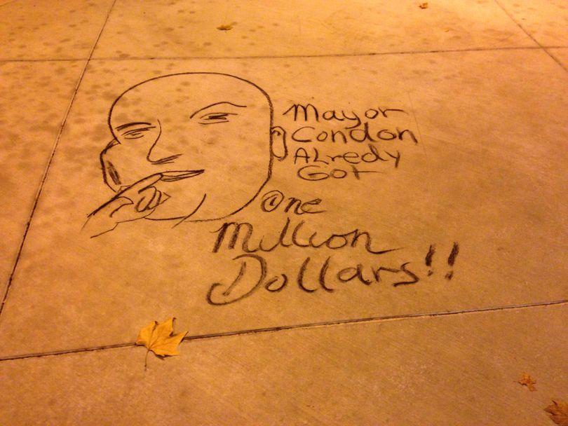 A sidewalk chalk drawing by Rick Bocook, AKA Harpman Hatter, of Dr. Evil referring to Spokane Mayor David Condon inheriting $1 million. (Nicholas Deshais)