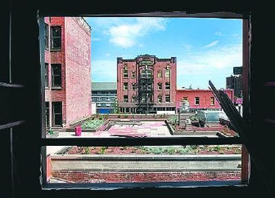 A view from the elevator tower behind the Saranac Hotel building, left, shows the rooftop garden and future patio of the restaurant.  (Photo by Holly Pickett / The Spokesman-Review)