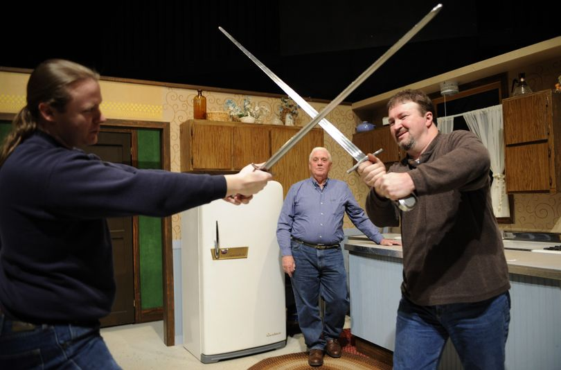 """During auditions for """"I Hate Hamlet,"""" fight coordinator Brian Rempel, left, and Ignite! Community Theatre's artistic director, Scott Finlayson cross swords, while Richard Donnelly waits to audition for the role of John Barrymore. """"I Hate Hamlet"""" opens April 12. (Colin Mulvany)"""